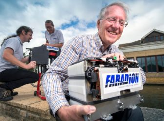 Chris Wright, the chairman of Faradion, with the sodium-ion electric car battery developed by the company. Photograph Adrian Sherratt